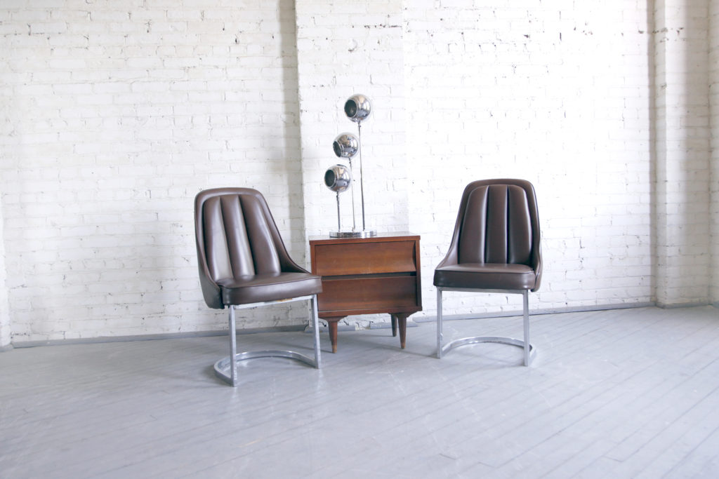 Pair of mid century modern chrome / vinyl chairs