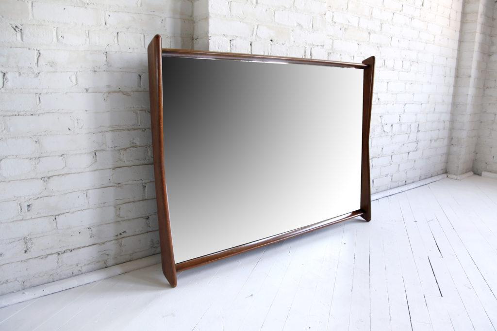 Mid century modern sculptural wood framed mirror